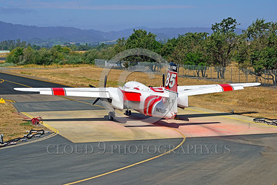 FF-S-2 00017 An elevated quarter rear view of a static Grumman S-2 Tracker ex-anti-submarine warfare airplane now Cal Fire 85 Santa Rosa 8-2015 fire fighting airplane picture by Peter J Mancus