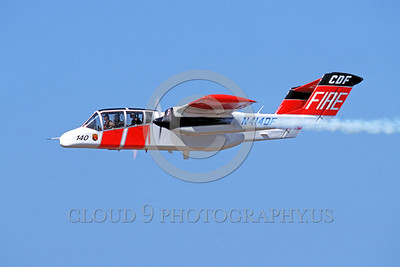 FF-OV-10 00004 A flying North American OV-10 Bronco N414DF CDF fire fighting airplane picture by Peter J Mancus