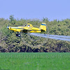 CropDuster 0028 A low flying Air Tractor Inc  AT-401 crop duster, N9179N, spraying a field in Wasco, California 8-2017 crop duster picture by Peter J  Mancus     DOMEwt