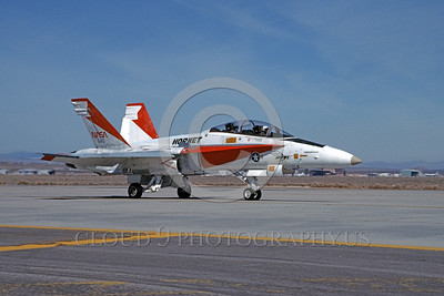 NASA-F-18 00009 A taxing red and white McDonnell Douglas F-18B Hornet NASA 845 Edwards AFB 5-1990 NASA airplane picture by Ben Ashcraft