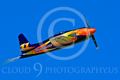 Race Airplane Rare Bear 00034 Grumman F8 Bearcat race airplane Rare Bear N777L at Reno air races by Peter J Mancus
