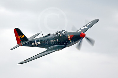 WB - Bell P-63 Kingcobra 00012  A Bell P-63 Kingcobra warbird, Pretty Polly, in flight, by Peter J Mancus