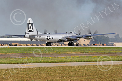 WB - B-29 00011 Fifi, a World War II era US Army Air Force Boeing B-29 Superfortress warbird, on a take-off roll at the Oshkosh 2011 airshow, airplane picture, by Peter J Mancus