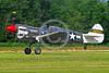 WB-Curtiss P-40 Warhawk 00145 A skull head Curtiss P-40 Warhawk USA WWII era fighter take-off roll warbird picture by Stephen W  D  Wolf