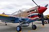 SM-P-40 013 A static British RAF color scheme sharkmouth Curtiss P-40 Warhawk American World War II era fighter warbird at Chino Planes of Fame 2016 airshow warbird picture by Peter J  Mancus