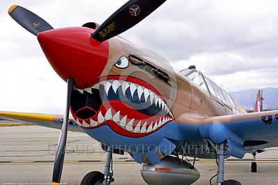 SM-P-40 007 A static British RAF color scheme sharkmouth Curtiss P-40 Warhawk American design World War II era fighter warbird at Chino Planes of Fame 2016 airshow warbird picture by Peter J  Mancus tif