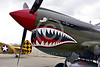 SM-P-40 008 A static olive drab color scheme sharkmouth Curtiss P-40 Warhawk American World War II era fighter warbird at Chino Planes of Fame 2016 airshow warbird picture by Peter J  Mancus tif