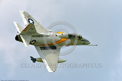 WB-A-4 0003 A top quarter rear view of a flying Douglas TA-4F Skyhawk US Cold War era sub-sonic attack jet trainer in USMC markings warbird at Thunder Over Michigan 2016 airshow warbird picture by Peter J  Mancus