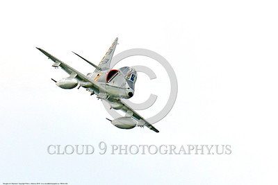 WB-A-4 0004 A flying, turning, diving, Douglas TA-4F Skyhawk US Cold War era sub-sonic attack jet trainer in USMC markings warbird at Thunder Over Michigan 2016 airshow warbird picture by Peter J  Mancus