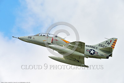 WB-A-4 0024 A climbing Douglas TA-4F Skyhawk US Cold War era sub-sonic attack jet trainer in USMC markings warbird at Thunder Over Michigan 2016 airshow warbird picture by Peter J  Mancus