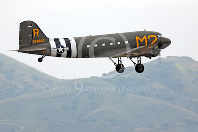 WB - Douglas C-47 Skytrain 00048 A Douglas C-47 Skytrain warbird takes off in front of foot hills, by Peter J Mancus