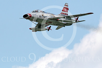 WB - F-100 00040 A North American F-100F Super Sabre USAF jet fighter, FW-948 63948, warbird flies pass a cloud, by Peter J Mancus