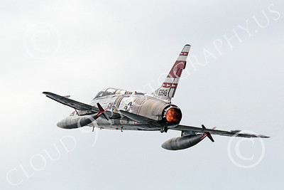 WB - F-100 00010 An in-flight North American F-100F Super Sabre USAF jet fighter, FW-948 63948, warbird climbs in full afterburner, by Peter J Mancus