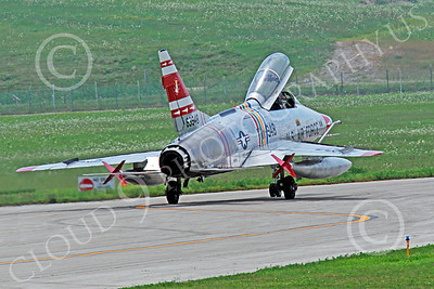 WB - F-100 00005 A North American F-100F Super Sabre USAF jet fighter, FW-948 63948 warbird, taxis for take-off, by Peter J Mancus
