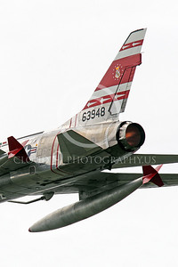 WB - F-100 00016 Close up of the tail and afterburner of a flying North American F-100F Super Sabre USAF jet fighter, FW-948 63948, warbird, by Peter J Mancus