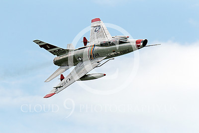 WB - F-100 00034 A flying North American F-100F Super Sabre USAF jet fighter warbird, FW-948 63948, makes a high speed pass, by Peter J Mancus