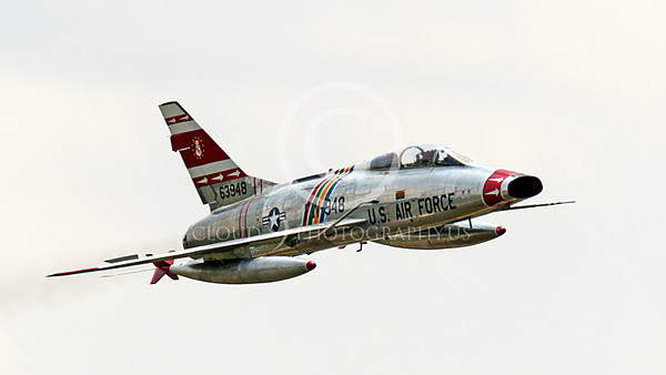 WB - F-100 00036 A flying North American F-100F Super Sabre USAF jet fighter, FW-948 63948, warbird, by Peter J Mancus