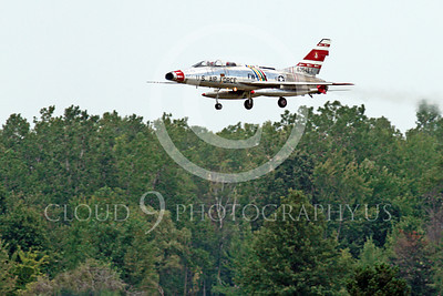 WB - F-100 00028 A North American F-100F Super Sabre USAF jet fighter, FW-948 63948, warbird in landing configuration above a tree line, by Peter J Mancus