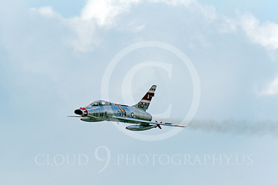 WB - F-100 00024 A flying North American F-100F Super Sabre USAF jet fighter, FW-948 63948, warbird leaves a smoke trail, by Peter J Mancus