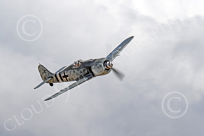 WB - Focke-Wulf Fw 190 00044 A flying German Focke-Wulf Fw 190 with a background of clouds, by Peter J Mancus