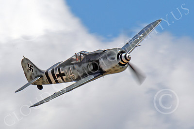 WB - Focke-Wulf Fw 190 00024 An in-flight Focke-Wulf Fw 190 German WWII era fighter in front of clouds, airplane picture, by Peter J Mancus