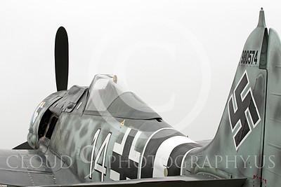 WB - Focke-Wulf Fw 190 00017 A static Focke-Wulf Fw 190 under an overcast sky, by Peter J Mancus