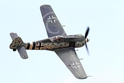 WB - Focke-Wulf Fw 190 00054 A flying Focke-Wulf Fw 190 German WWII era fighter warbird airplane picture, by Peter J Mancus
