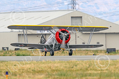 WB - Grumman F3F 00023 A Grumman F3F biplane fighter warbird rolls out after landing, airplane picture, by Peter J Mancus