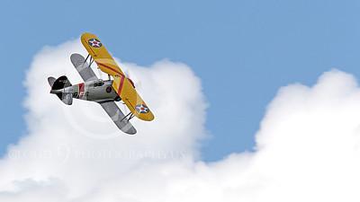 WB - Grumman F3F 00054 A Grumman F3F biplane fighter warbird cavorts among clouds, by Peter J Mancus