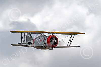 WB - Grumman F3F 00046 An excellent quarter front view of a flying Grumman F3F biplane fighter warbird, airplane picture, by Peter J Mancus