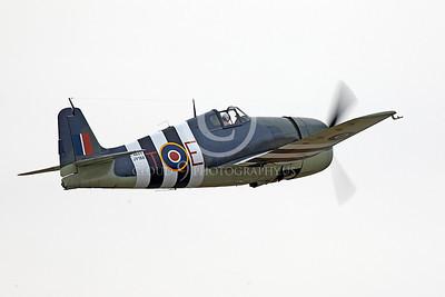 WB - Grumman F6F Hellcat 00044 Grumman F6F Hellcat British RAF warbird in flight, by Peter J Mancus