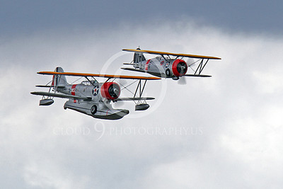 WB - Grumman J2F Duck 00010 A USMC Grumman J2F Duck float plane warbird in formation with a Grumman F3F biplane fighter warbird, by Peter J Mancus