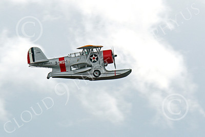 WB - Grumman J2F Duck 00020 A flying USMC Grumman J2F Duck float plane warbird airplane picture, by Peter J Mancus