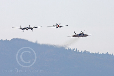 HF - 00039 Lockheed P-38 Lightning, North American P-51D Mustang, and Lockhee Martin F-22 Raptor by Peter J Mancus