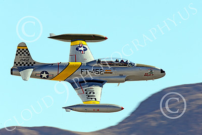 WB-T-33 00014 A flying Lockheed T-33 Shooting Star USAF jet trainer, ACE MAKER II, makes a low high speed pass, warbird picture by Peter J Mancus