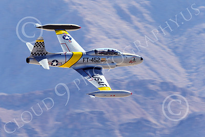 WB-T-33 00018 A flying Lockheed T-33 Shooting Star USAF jet trainer, ACE MAKER II, makes a low high speed pass, warbird picture by Peter J Mancus