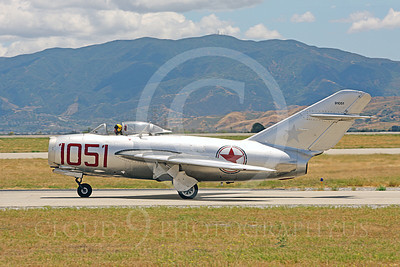 WB - MiG-15 00027 Side view of a taxing Mikoyan-Guryevich MiG-15 Fagot jet fighter warbird airplane picture by Peter J Mancus