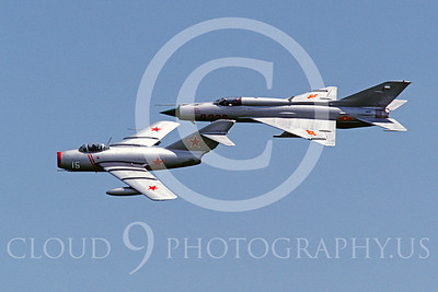 WB - MiG-15 00010 Mikoyan-Guryevich MiG-15 Fagot Soviet Air Force markings warbird and Mikoyan-Guryevich MiG-21 Fishbed North Vietnamese Air Force markings warbird by Peter J Mancus