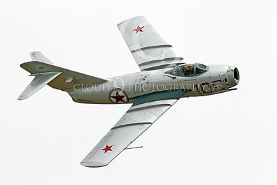WB - MiG-15 00012 A flying Mikoyan-Guryevich MiG-15 Fagot jet fighter warbird airplane picture by Peter J Mancus