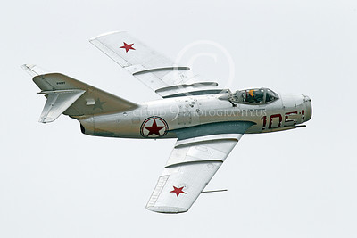 WB - MiG-15 00016 A flying Mikoyan-Guryevich MiG-15 Fagot jet fighter warbird airplane picture by Peter J Mancus