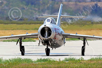 WB - MiG-15 00009 A taxing Mikoyan-Guryevich MiG-15 Fagot jet fighter warbird airplane picture by Peter J Mancus