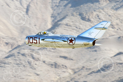 WB-MiG-15 00046 A flying Mikoyan-Gurevich MiG-15 Fagot Soviet jet figher flying low, warbird picture by Peter J Mancus