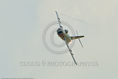 WB-MiG-17 00033 A turning Mikoyan-Guryevich MiG-17 Fresco Soviet Cold War era supersonic jet fighter warbird in afterburner in Polish Air Force markings in cloudy skies at Thunder Over Michigan 2016 airshow warbird picture by Peter J  Mancus