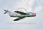 WB-MiG-17 00031 Side view of a banking flying Mikoyan-Guryevich MiG-17 Fresco Soviet Cold War era supersonic jet fighter warbird in Polish Air Force markings at Thunder Over Michigan 2016 ai ...