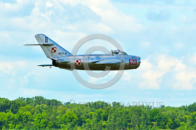 WB-MiG-17 00048 A low flying Mikoyan-Guryevich MiG-17 Fresco Soviet Cold War era supersonic jet fighter in Polish Air Force markings at Thunder Over Michigan 2016 airshow warbird picture by Peter J  Mancus