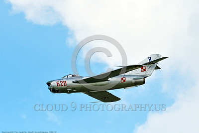 WB-MiG-17 00027 Side view of a flying Mikoyan-Guryevich MiG-17 Fresco Soviet Cold War era supersonic jet fighter warbird in Polish Air Force markings at Thunder Over Michigan 2016 airshow warbird picture by Peter J  Mancus