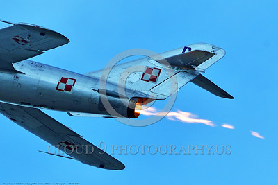 WB-MiG-17 00040 A tight crop of the tail and afterburner flame of a flying Mikoyan-Guryevich MiG-17 Fresco Soviet Cold War era supersonic jet fighter at Thunder Over Michigan 2016 airshow warbird picture by Peter J  Mancus