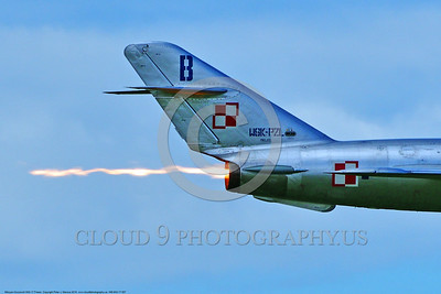 WB-MiG-17 00057 A tight crop of the tail and afterburner flame of a flying Mikoyan-Guryevich MiG-17 Fresco Soviet Cold War era supersonic jet fighter at Thunder Over Michigan 2016 airshow warbird picture by Peter J  Mancus