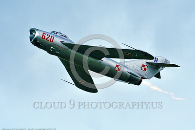 WB-MiG-17 00058 A climbing Mikoyan-Guryevich MiG-17 Fresco Soviet Cold War era supersonic jet fighter in afterburner and Polish Air Force markings at Thunder Over Michigan 2016 airshow warbird picture by Peter J  Mancus