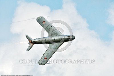 WB-MiG-17 00035 Bottom view of a turning Mikoyan-Guryevich MiG-17 Fresco Soviet Cold War era supersonic jet fighter in afterburner Polish Air Force markings in cloudy skies at Thunder Over Michigan 2016 airshow warbird picture by Peter J  Mancus